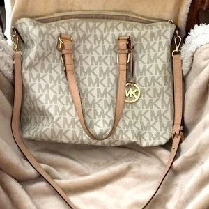Price is 70% off Michael Kors leather logo purse